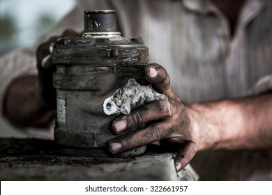 Worker at a Auto workshop cleaning the motor. Motion blur, noise