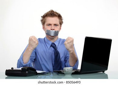 worker with a band on his mouth