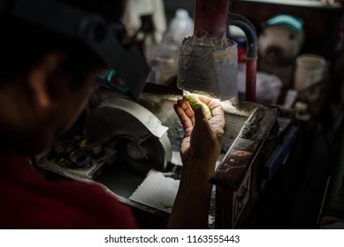 worker between gems cutting process in gems factory