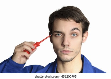 Worker in blue overall with screwdriver in hand
