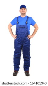 Worker in blue overalls. Isolated on a white background.