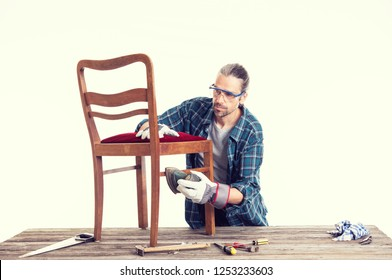 worker in blue plaid  shirt repair old chair