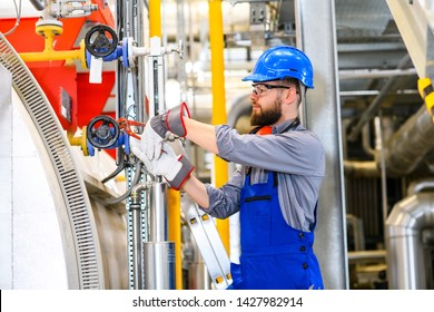 worker in blue work clothes  in industrial plant