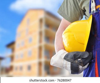 Worker and the blurred construction in background
