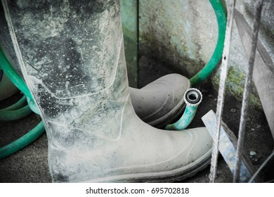 Worker boots in the construction site
