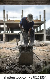Worker breaks a concrete base with a pneumatic hammer - 2017