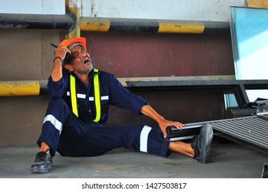 Worker with broken leg because iron falling on the legs at warehouse construction.