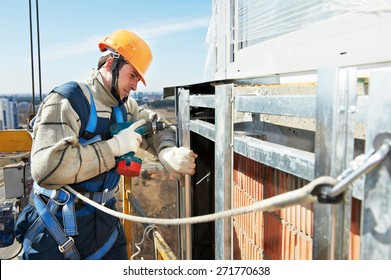 worker builder make ventilation facade construction on a high building
