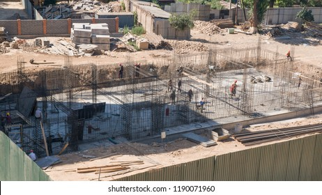 worker and builder on the construction site, top view. the finished foundation of a building under construction