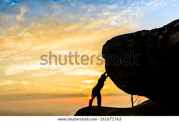 Worker, businessman pushing uphill a heavy stone - Symbol of the difficulties leader, hard work, hard to the effort