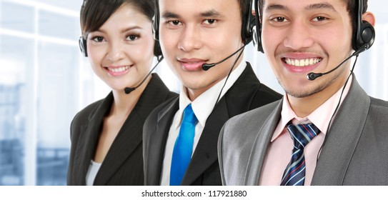 worker call center smiling with colleague in background