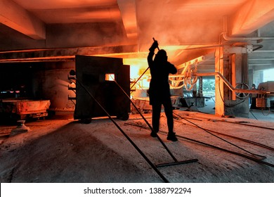 A worker is carrying out his duties at a carbide factory in Sidoarjo, East Java, Indonesia, on April 22, 2015.