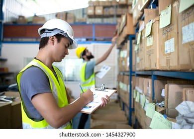 Worker checking stock products in Warehouse