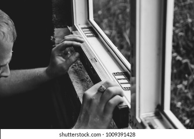 worker checks the level of a window