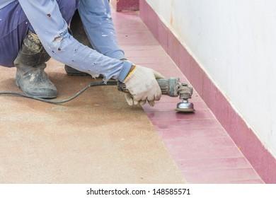 worker clean the floor using electric motor brushing