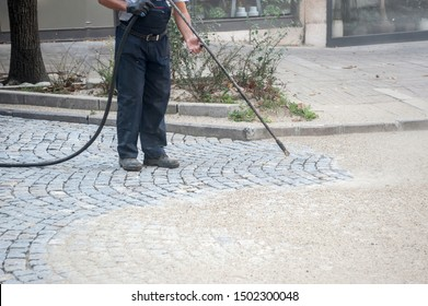 worker, cleaning the streets with a breeze of air