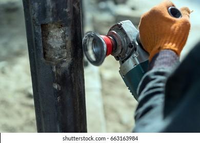 Worker cleans metal