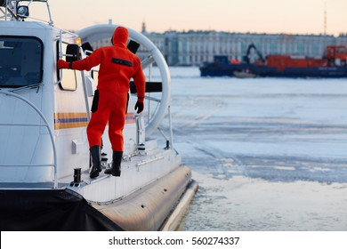 Worker of coast guard team on rescue boat