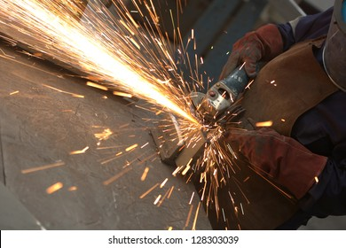 worker in constructing industry grinding metal