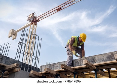 Worker At Construction Site Is Fixing The Form For The Beam