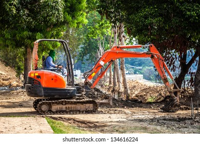 Worker control bull dozer to level the ground