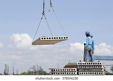 Worker Control crane move the hollow core slab blue sky background