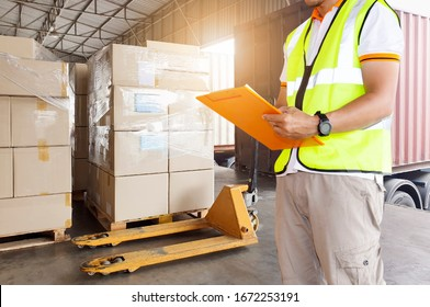 Worker courier holding clipboard inspecting checklist load shipment goods into a truck, Freight industry warehouse logistics transport,  forklift pallet jack and stack package boxes.