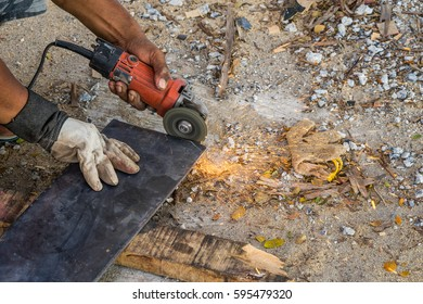 worker with cut off machine