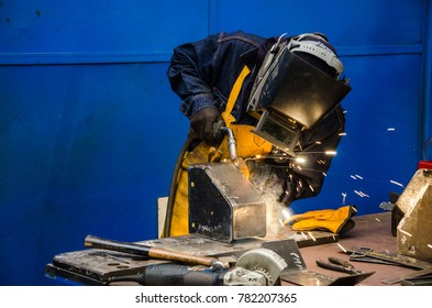 worker cutting iron with his tool