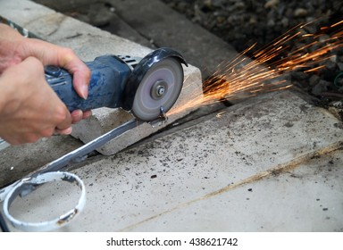 Worker cutting metal with unsafety.