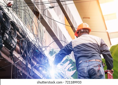Worker is cutting power cable.The electrician made a bad mistake and was electrocuted.Electricians are dismantling the wiring from the building.