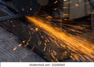 Worker are cutting steel