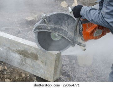 Worker cutting stone block by cutter machine.