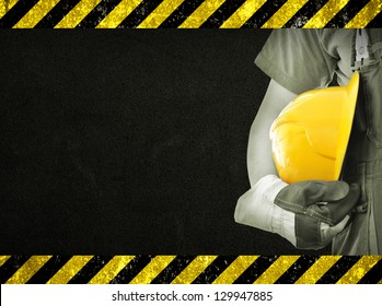 Worker and dark texture in background. Concept of OSH (occupational safety and health)