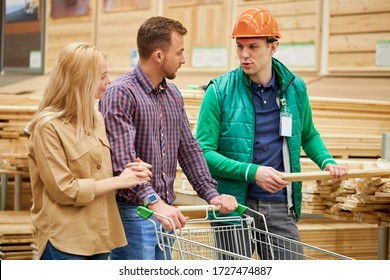 worker of distribution center consult married couple in market, they came to buy some building material made from wood for building their new house