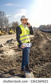 worker engineer in construction helmet talking on the phone