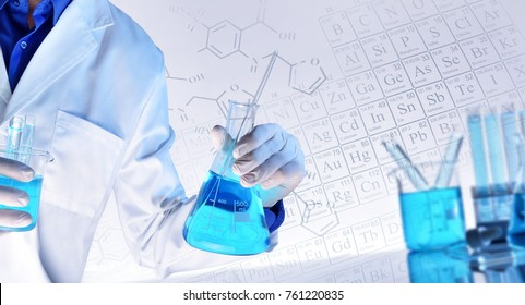 Worker equipped with workwear and laboratory chemical material with representation of chemical elements and structures in the background. Representation of chemical sciences teaching concept.