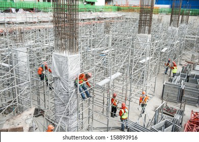 Worker to erect scaffolding on construction site