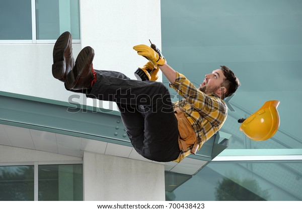 Worker falling from ledge outside building