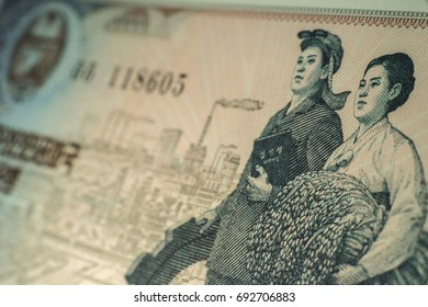 The worker and farmer in a North Korea banknote for macro