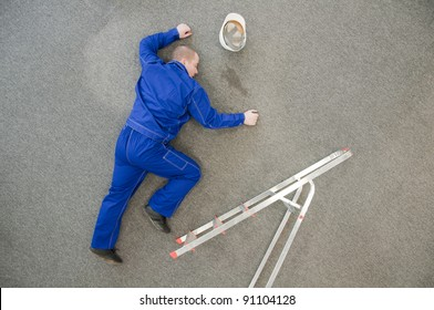 worker fell from a ladder and lies on the floor