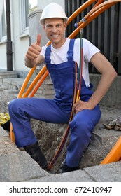 A Worker at Fiber optic broadband construction site