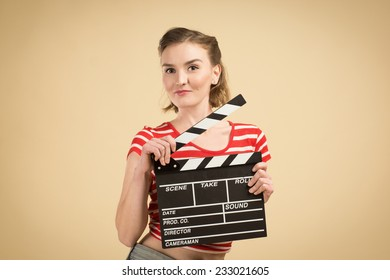 worker film industry/ young girl with a clapperboard cinema