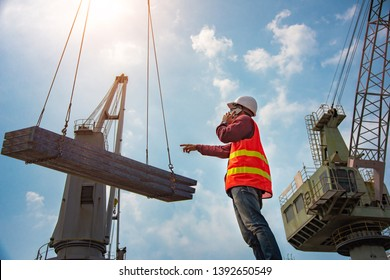 worker, foreman, loading master or engineering works while keep talking on mobile phone online, report online speaking on mobile phone, works careless and inattention at risk, high level insurance