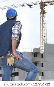 worker in front of crane