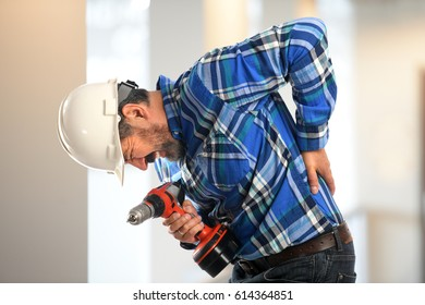Worker getting back pain inside building
