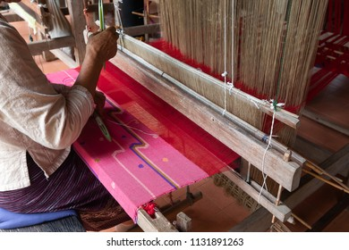 worker girl weaving the ancient Loom