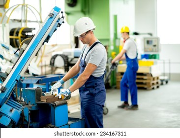 worker with goggles and helmet on the machine