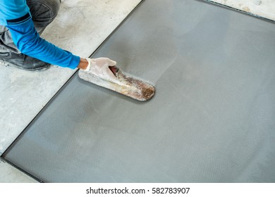 worker are going to use durable wood plastering mixed cement