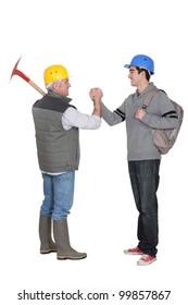 Worker greeting apprentice